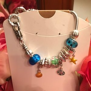 Beautiful silver bracelet full multicolor charms